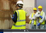 Tutor_demonstrationg_Lime_mortar_Ashlar_pointing_to_candidates_on_the_Dalkeith_THI_Programme